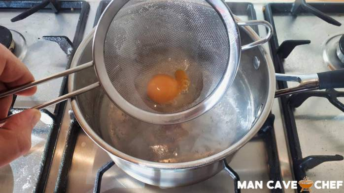Lower egg into water