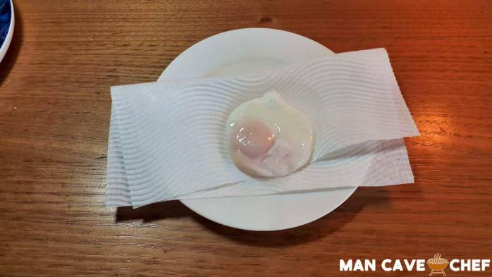 Poached egg on paper towel